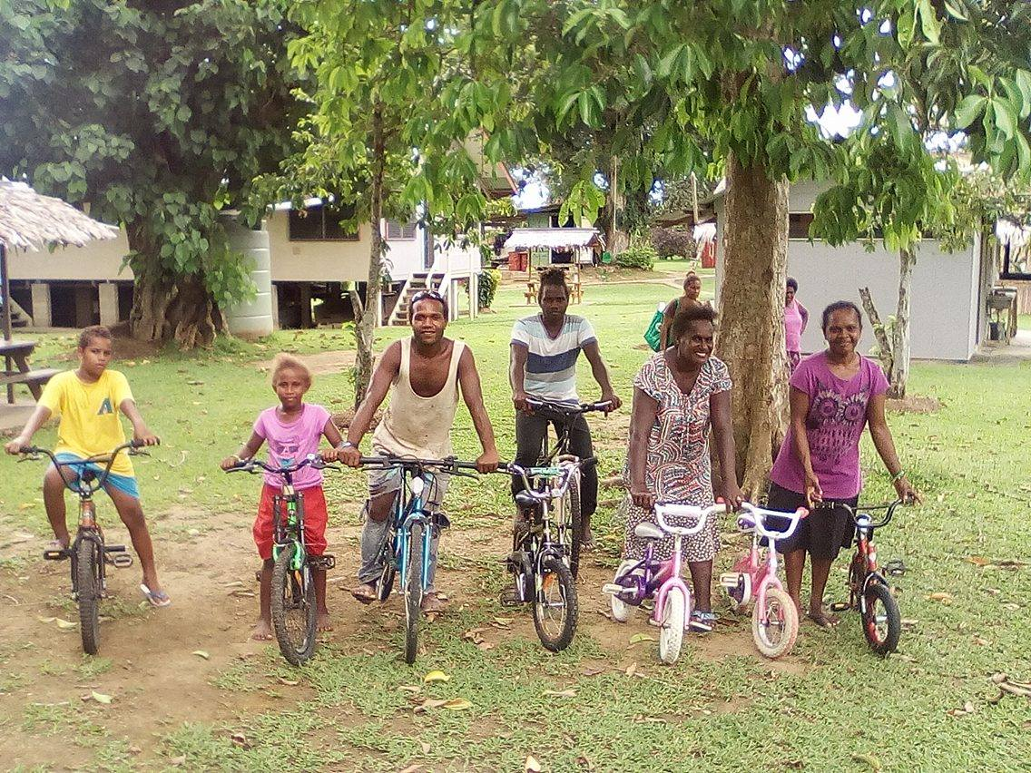 Some happy recipients of the bikes that were taken over in the container